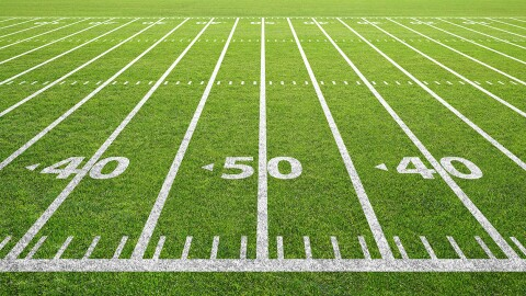 yard lines painted on  football field turn