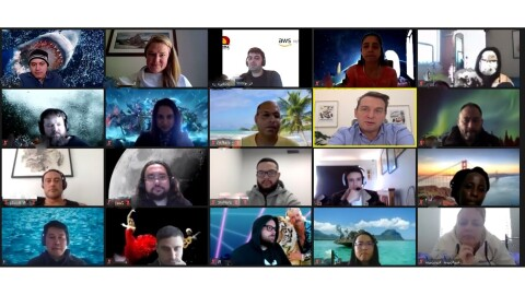 A grid of more than a dozen people engaged in a video call for online education.
