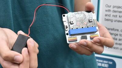 Students participate in a science fair experience through amazon.sg robotics program