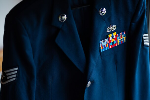 A blue blazer with military insignia.