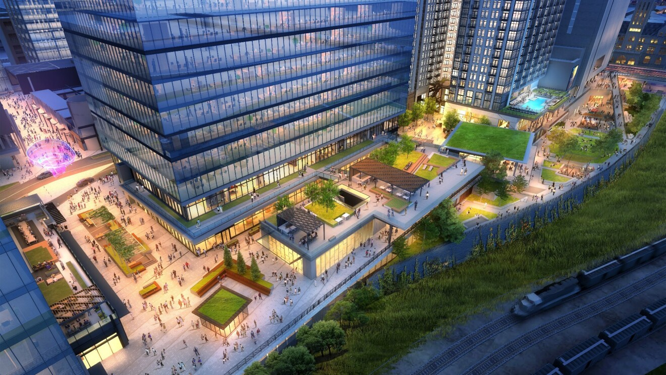 Preview of the new Amazon building coming to Nashville, Tennessee. Street view of the exterior of the building and surrounding sidewalks and green space.
