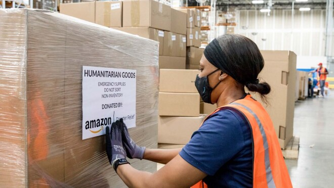 An Amazon employee readies product to be used for disaster relief.