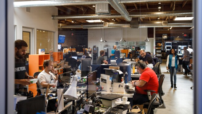 Long tables with Ring employees at Ring headquarters in Santa Monica, CA.