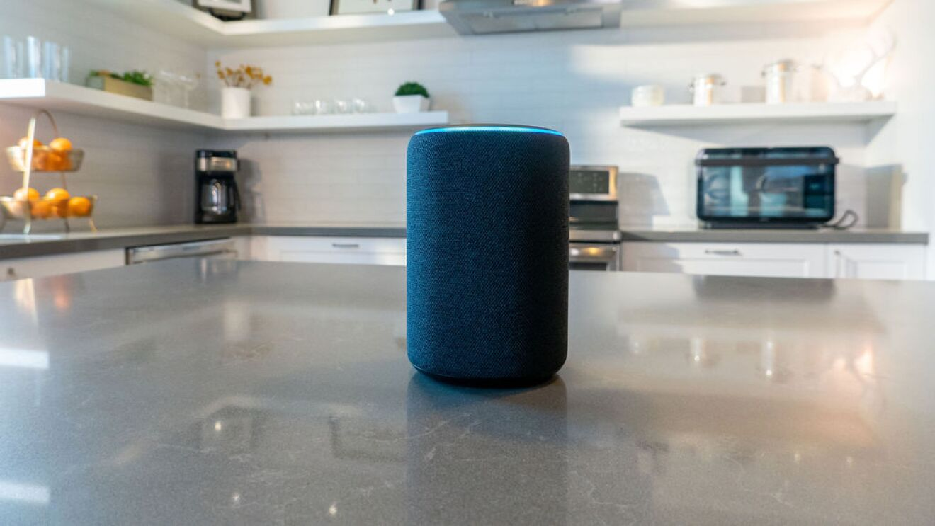 An Echo device on a kitchen island in a home.