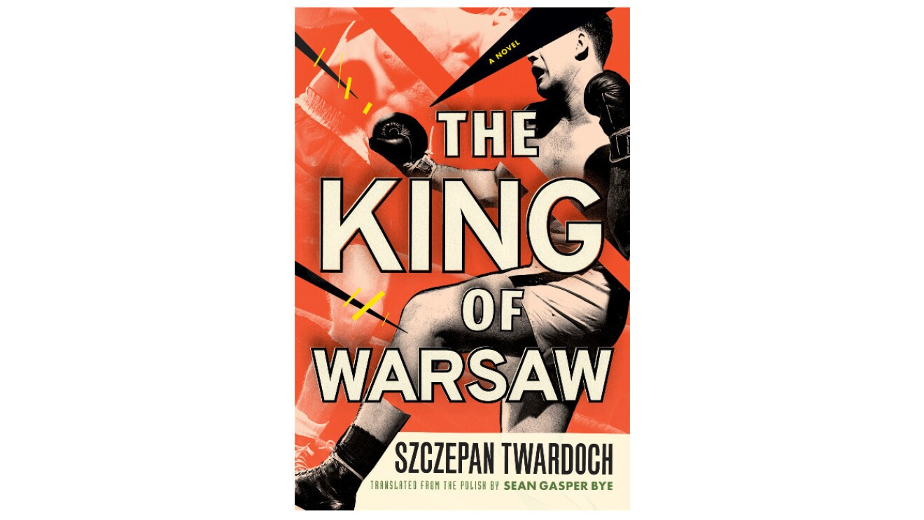 """The book cover of """"The King of Warsaw""""  is a vintage orange color. The cover features a male boxer wearing shorts and boxing gloves punching his opponent whose image is faded."""